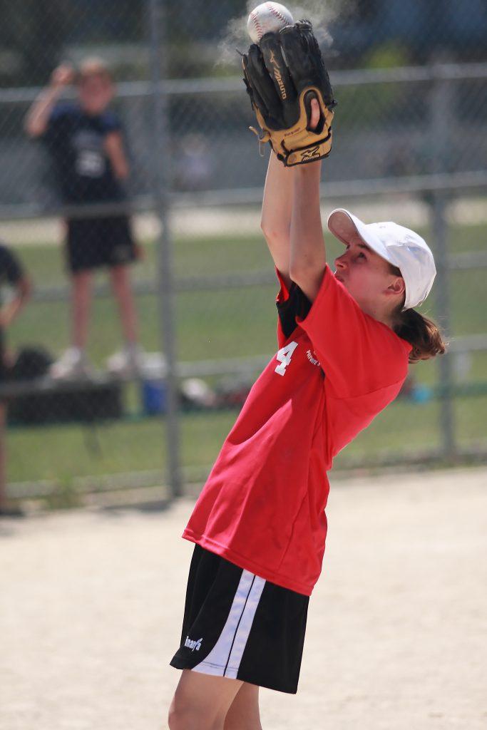 Newton's Grove School girl catching baseball