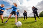 Newtons Grove School girls soccer team playing soccer